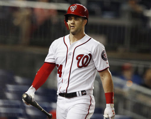 Washington Nationals' Bryce Harper walks to the dugout after he lined out to first during the ninth inning of the team's baseball game against the Baltimore Orioles at Nationals Park, early Thursday, June 21, 2018, in Washington. The Orioles won 3-0. (AP Photo/Carolyn Kaster)