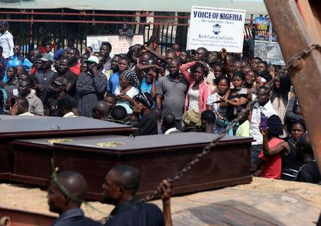 People react as a truck carries the coffins of people killed by the Fulani herdsmen, in Makurdi, Nigeria January 11, 2018. REUTERS/Afolabi Sotunde