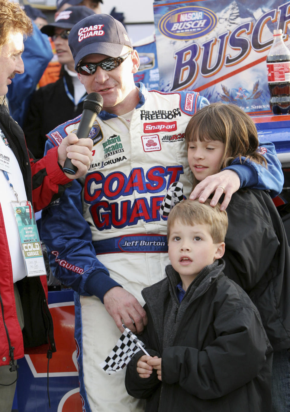 FILE - In this March 18, 2006, file photo, Jeff Burton puts his arm around his children Paige, 10, and Harrison, 5, as he is interviewed in victory lane after winning the NASCAR Busch Series' Nicorette 300 auto race at Atlanta Motor Speedway in Hampton, Ga., in this Saturday, March 18, 2006, file photo. Harrison Burton is set to make his NASCAR Cup Series debut at Talladega Superspeedway. (AP Photo/Gene Blythe, File)