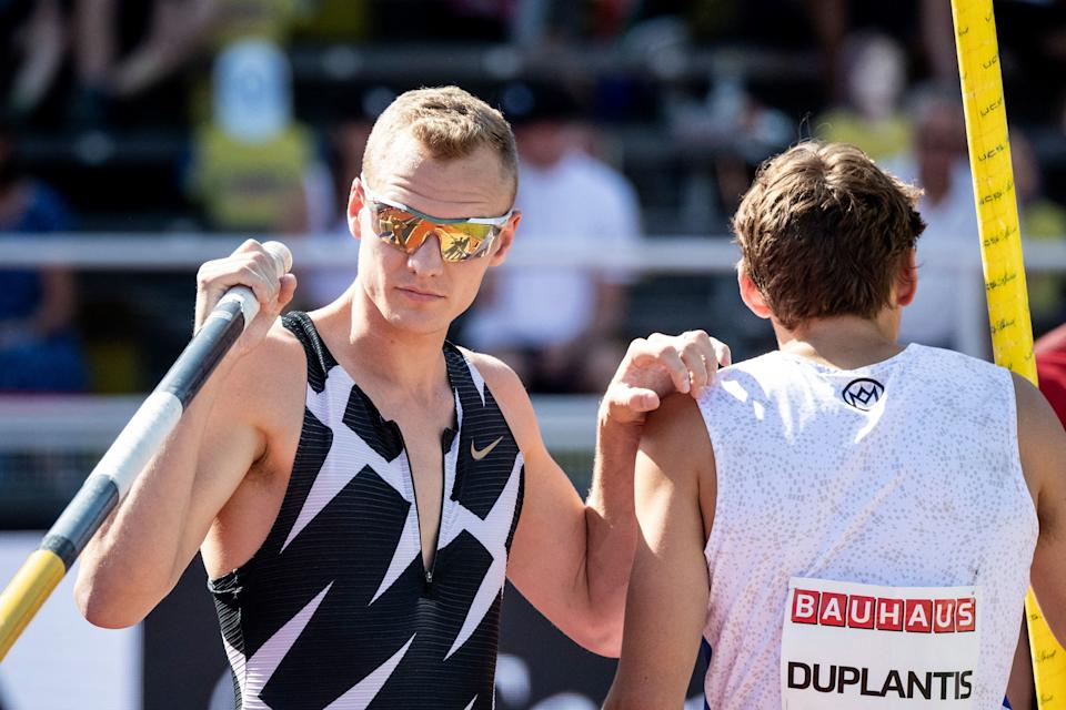 Sam Kendricks (L) of the US and Sweden's Armand Duplantis compete in the men's final pole vault event during the Diamond League Track and Field meeting in Stockholm, on July 4, 2021. - Sweden OUT (Photo by Christine OLSSON / TT NEWS AGENCY / AFP) / Sweden OUT (Photo by CHRISTINE OLSSON/TT NEWS AGENCY/AFP via Getty Images)