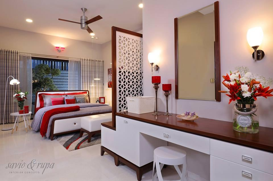 Spacious Master bedroom with a private deck space and garden and an attached dressing area.
