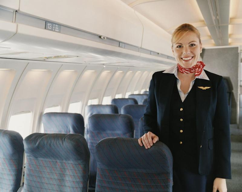 Here's what the flight attendants are really talking about over the loudspeaker. Photo:Getty Images.