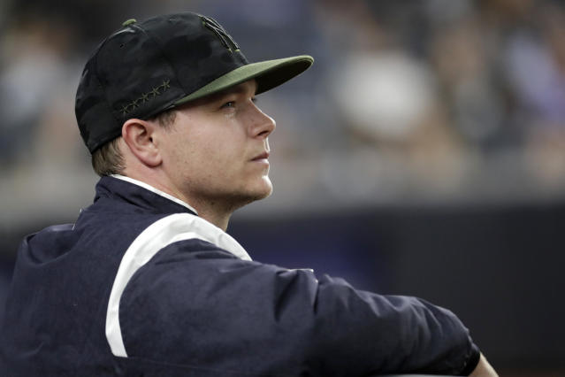 New York Yankees starting pitcher Sonny Gray watches from the dugout after being pulled from the baseball game during the fourth inning against the Los Angeles Angels, Saturday, May 26, 2018, in New York. (AP Photo/Julio Cortez)