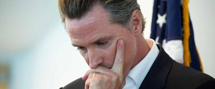 Sacramento, California / USA - May 31,  2020: California State Governor Gavin Newsom holds his head in though before a meeting.