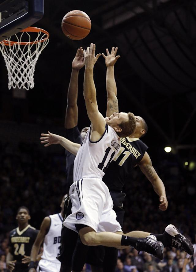 Butler's Jackson Aldridge (11) puts up a shot against Vanderbilt's Kyle Fuller (11) during the first half of an NCAA college basketball game Tuesday, Nov. 19, 2013, in Indianapolis. (AP Photo/Darron Cummings)