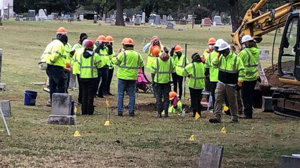 PHOTO: A work crew examines a grave containing what may be the remains of victims of the 1921 Tulsa Race Massacre, at Oaklawn Cemetery in Tulsa, Okla., Oct. 21, 2020. (Tonya Simpson/ABC News)