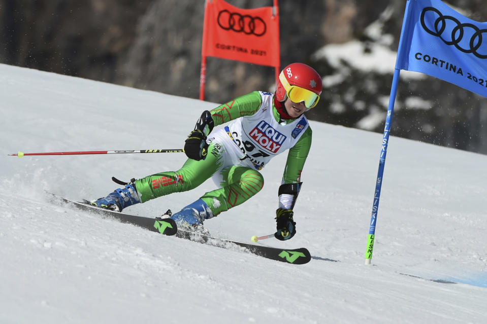 Iran's Forough Abbasi speeds down the course during a women's giant slalom, at the alpine ski World Championships, in Cortina d'Ampezzo, Italy, Thursday, Feb. 18, 2021. (AP Photo/Marco Tacca)