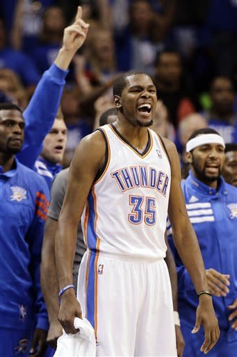 Oklahoma City Thunder small forward Kevin Durant (35) leads the cheer against the San Antonio Spurs during the first half of Game 3 in their NBA basketball Western Conference finals playoff series, Thursday, May 31, 2012, in Oklahoma City. (AP Photo/Eric Gay)