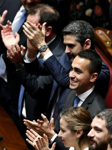 Five Stars Mouvement (M5S) leader Luigi Di Maio (centre) and M5S deputies applaud in parliament shortly after the March election