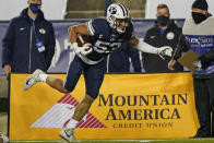 BYU linebacker Isaiah Kaufusi (53) carries the ball after an interception against Texas State in the second half during an NCAA college football game Saturday, Oct. 24, 2020, in Provo, Utah. (AP Photo/Rick Bowmer)