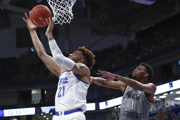 Pittsburgh's Terrell Brown (21) shoots in front of Wake Forest's Isaiah Mucius (1) during the first half of an NCAA college basketball game, Saturday, Jan. 4, 2020, in Pittsburgh. (AP Photo/Keith Srakocic)