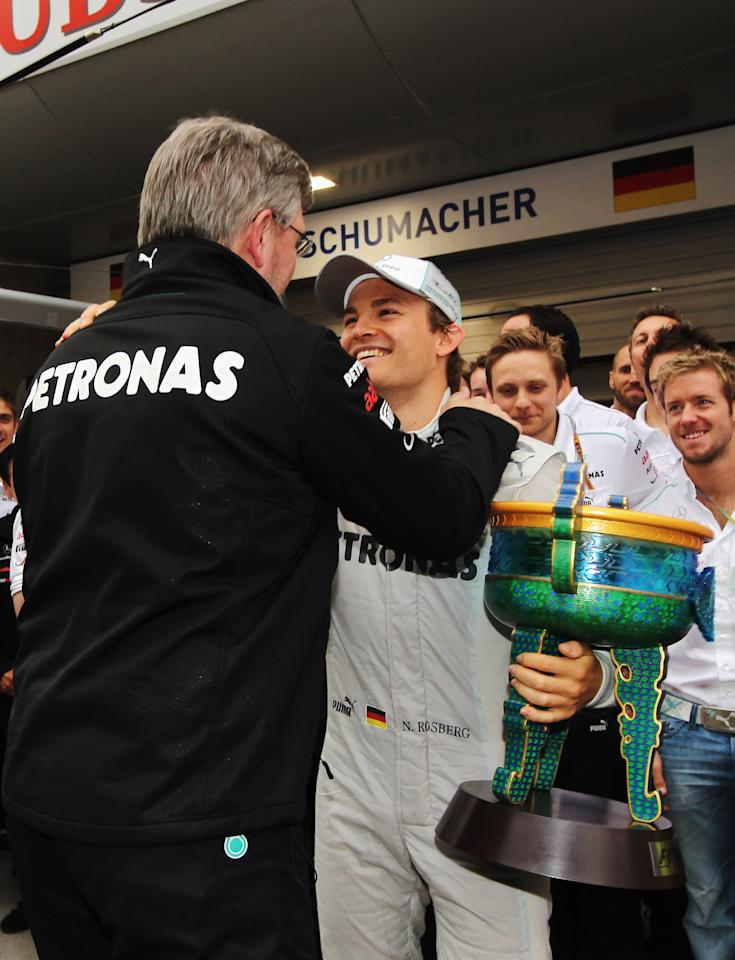 SHANGHAI, CHINA - APRIL 15:  Race winner Nico Rosberg of Germany and Mercedes GP celebrates with team mates including his Team Principal Ross Brawn the pitlane following the Chinese Formula One Grand Prix at the Shanghai International Circuit on April 15, 2012 in Shanghai, China.  (Photo by Mark Thompson/Getty Images)