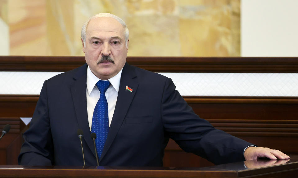 """FILE - In this Wednesday, May 26, 2021, file photo, Belarusian President Alexander Lukashenko addresses Parliament in Minsk, Belarus. Lukashenko defended the diversion of a commercial flight carrying dissident journalist Raman Pratasevich to Minsk, where he was arrested on Sunday, May 23, 2021. The diversion triggered bruising European Union sanctions and Lukashenko accused the West of trying to """"strangle"""" his country. (Sergei Shelega/BelTA Pool Photo via AP)"""