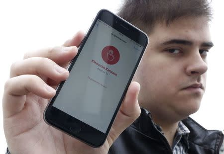 "Developer of the ""Red Button"" phone application Alexander Litreev poses for a picture in Moscow"