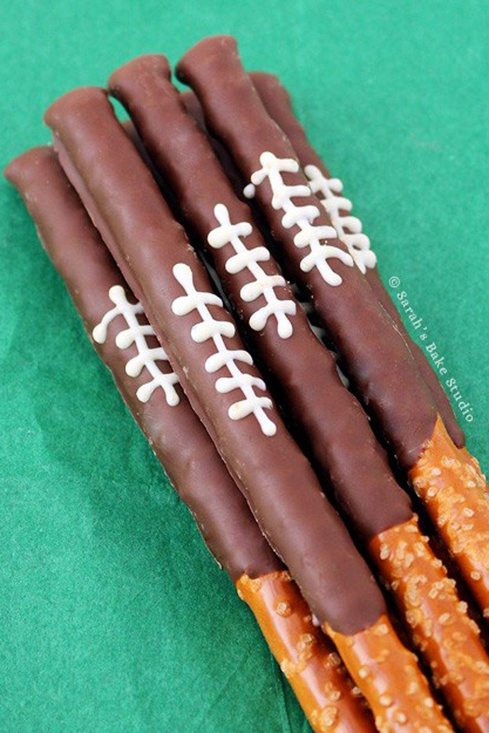 """<p>You won't be able to have just one of these salty, sweet pretzels.</p><p><strong>Get the recipe at <a href=""""http://sarahsbakestudio.com/chocolate-football-pretzel-rods/"""" rel=""""nofollow noopener"""" target=""""_blank"""" data-ylk=""""slk:Sarah's Baking Studio"""" class=""""link rapid-noclick-resp"""">Sarah's Baking Studio</a>.</strong></p>"""
