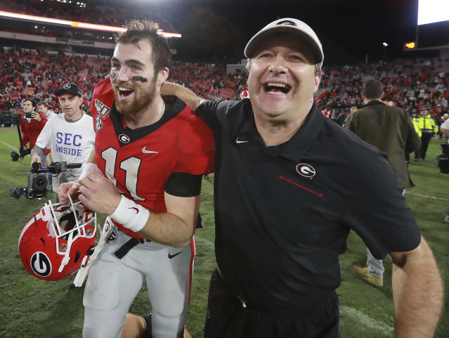 FILE - In this Nov. 23, 2019, file photo, Georgia head coach Kirby Smart and quarterback Jake Fromm celebrate beating Texas A&M 19-13 in an NCAA college football game, in Athens, Ga. Heading into this years slate of conference title games a case could be made that No. 1 LSU (No. 2 CFP), No. 2 Ohio State (No. 1 CFP) and No. 3 Clemson (No. 3 CFP) have all done enough already to lose their conference championship games and still get in the College Football Playoff. (Curtis Compton/Atlanta Journal-Constitution via AP, File)