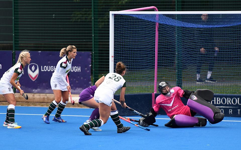 Students to fore: Loughborough's Miriam Pritchard thwarts a Surbiton attack - ANDREW SMITH