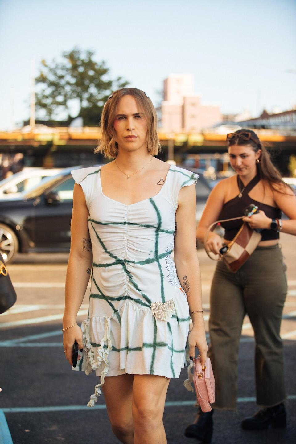 <p>She wore a ruched white dress with green stripes while admiring Collina Strada's rooftop runway show.</p>