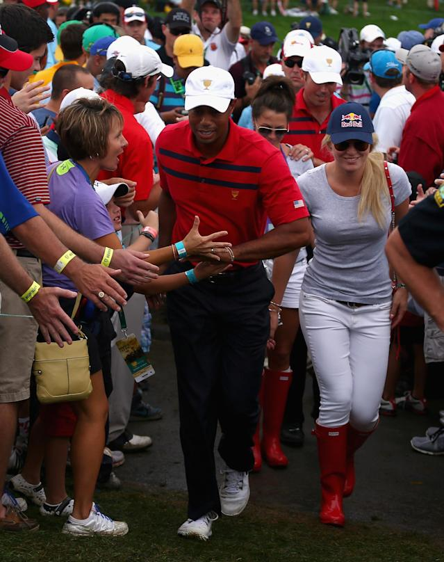 DUBLIN, OH - OCTOBER 05: Tiger Woods of the U.S. Team walks with girlfriend Lindsey Vonn during the Day Three Four-ball Matches at the Muirfield Village Golf Club on October 5, 2013 in Dublin, Ohio. (Photo by Andy Lyons/Getty Images)