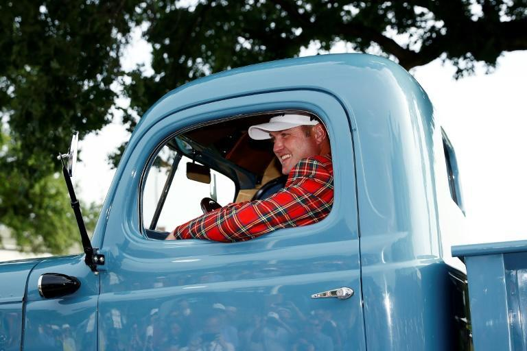In the driving seat: Jason Kokrak celebrates victory with his new 1946 Dodge Power Wagon