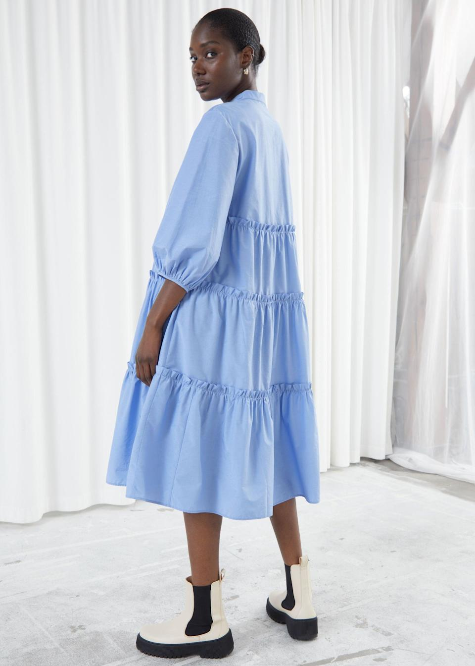 "<br><br><strong>& Other Stories</strong> Voluminous Tiered Puff Sleeve Midi Dress, $, available at <a href=""https://go.skimresources.com/?id=30283X879131&url=https%3A%2F%2Fwww.stories.com%2Fen_usd%2Fclothing%2Fdresses%2Fmidi-dresses%2Fproduct.voluminous-tiered-puff-sleeve-midi-dress-blue.0886121001.html"" rel=""nofollow noopener"" target=""_blank"" data-ylk=""slk:& Other Stories"" class=""link rapid-noclick-resp"">& Other Stories</a>"