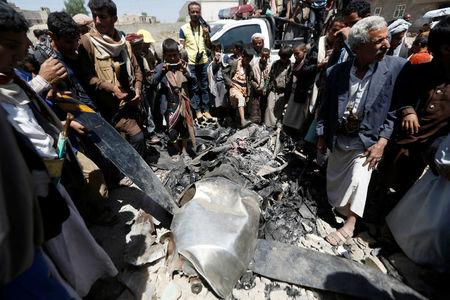 People gather around the engine of a drone aircraft which the Houthi rebels said they have downed in Sanaa, Yemen October 1, 2017. REUTERS/Khaled Abdullah