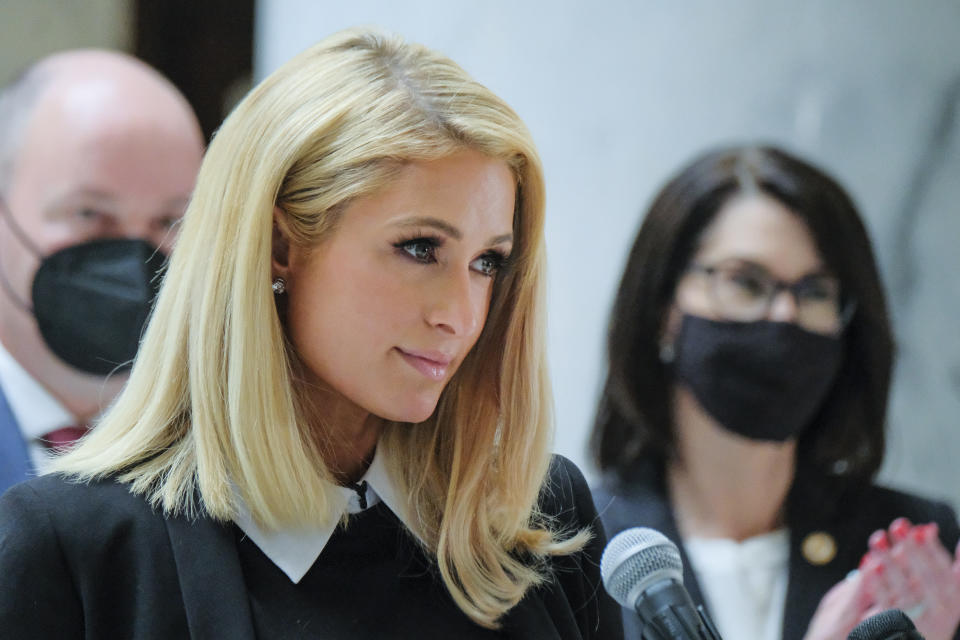 Paris Hilton, who has spoken out about the abuses she said she experienced at Provo Canyon School, center, was an advocate for the new law along with Utah Gov. Spencer Cox Cox and Lt. Gov. Deidre Henderson. Activists and supporters gathered in the Capitol rotunda in Salt Lake City, Tuesday, April 6, 2021, for a ceremonial bill signing of SB127 that will bring more oversight to the state's so-called troubled-teen industry. (Leah Hogsten/The Salt Lake Tribune via AP)