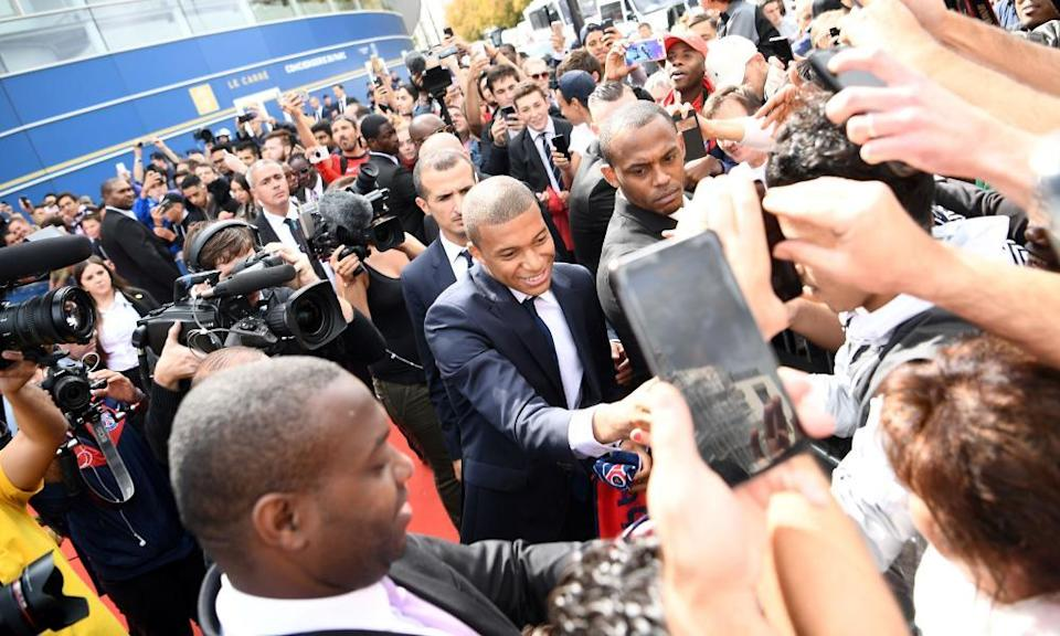 Paris Saint-Germain's new forward Kylian Mbappé greets fans following his presentation at the Parc des Princes stadium in September 2017. The 18-year-old striker moved to PSG in a season-long loan deal with a €180m buy-out clause attached.