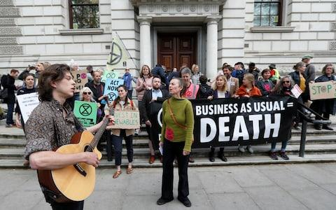 Climate protesters have targeted HM Treasury in Westminster - Credit: Peter Nicholls/Reuters