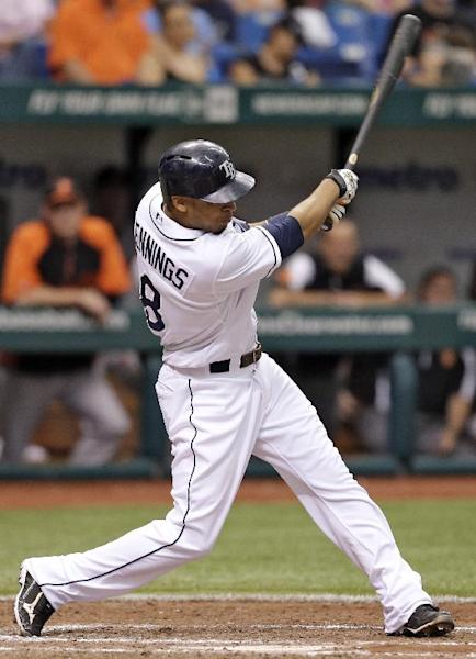 Tampa Bay Rays' Desmond Jennings hits a three-run home run off Baltimore Orioles starting pitcher Miguel Gonzalez during the fifth inning of a baseball game Saturday, Sept. 21, 2013, in St. Petersburg, Fla. The Rays' Jose Molina and Yunel Escobar also scored on the hit. (AP Photo/Chris O'Meara)