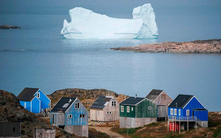 Icebergs float behind the town of Kulusuk in Greenland - AFP