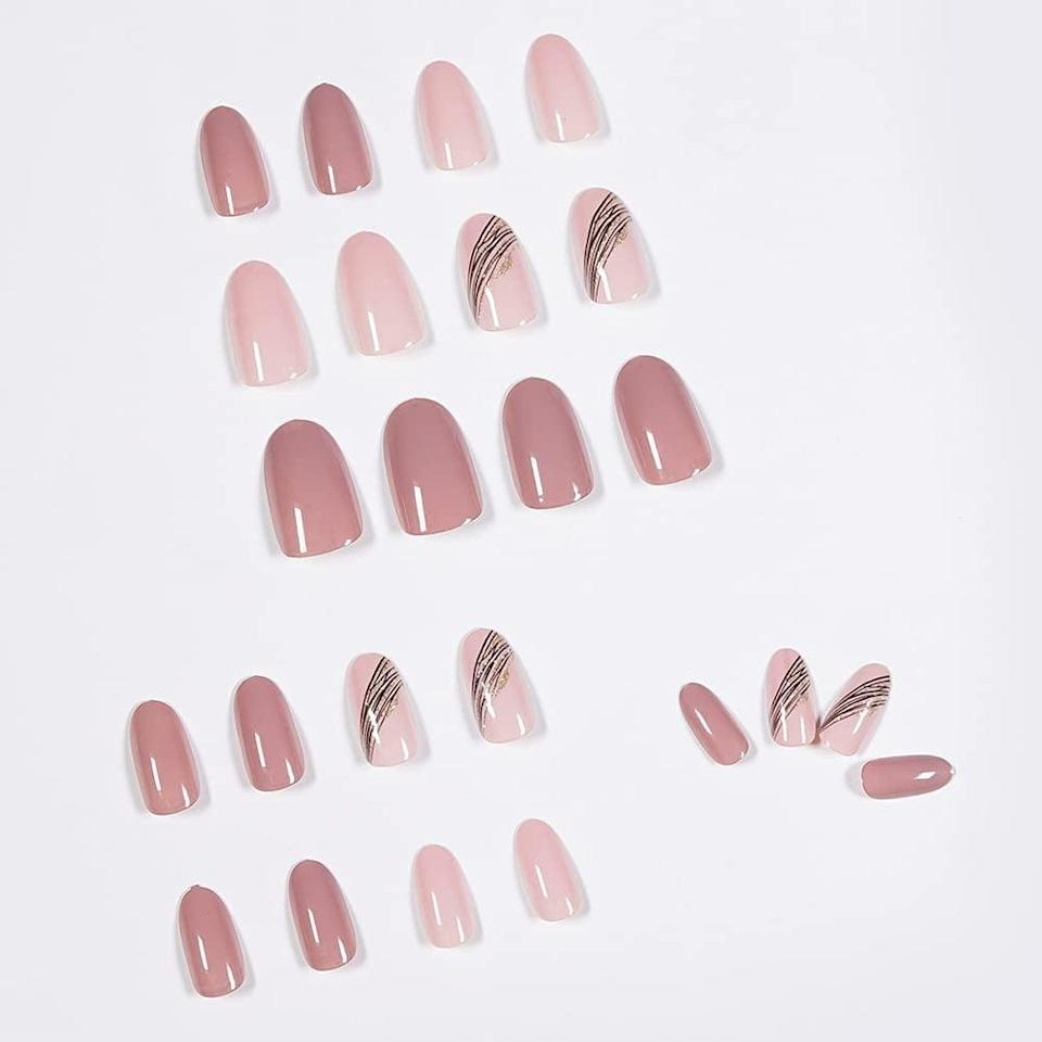 <p>If you like to keep your nails simple but want to step out of your comfort zone, these <span>Glossy Pink Almond Press on Nails with Designs</span> ($8) are so cute! The shades of muted pink will go with everything and minimalitic design adds a pop without being overwhelming. It comes with 24 pieces.</p>