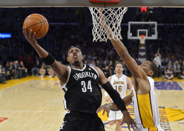 Brooklyn Nets forward Paul Pierce, left, puts up a shot as Los Angeles Lakers' Wesley Johnson defends during the first half of an NBA basketball, Sunday, Feb. 23, 2014, in Los Angeles. (AP Photo/Mark J. Terrill)