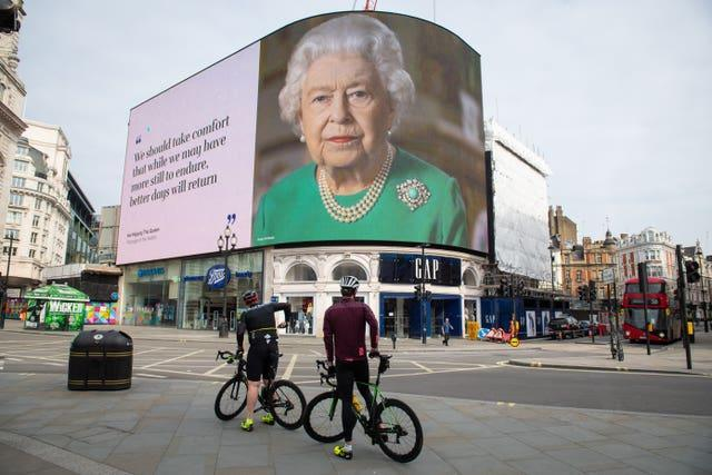 An image of the Queen and quotes from her broadcast to the UK and the Commonwealth in relation to the coronavirus epidemic displayed at London's Piccadilly Circus in April
