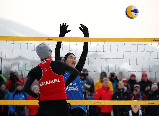 Pyeongchang 2018 Winter Olympics - Pyeongchang - South Korea – February 14, 2018. Kim Yeon-Koung of South Korea and Emanuel Rego of Brazil play during an event promoting the Snow Volleyball hosted by the International Volleyball Federation (FIVB) and European Volleyball Confederation (CEV). REUTERS/Kim Hong-Ji