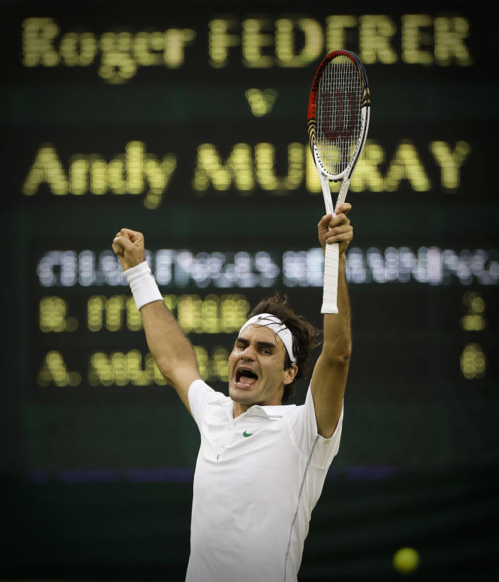 Roger Federer of Switzerland celebrates winning the men's singles final against Andy Murray of Britain at the All England Lawn Tennis Championships at Wimbledon, England, Sunday, July 8, 2012. (AP Photo/Anja Niedringhaus)