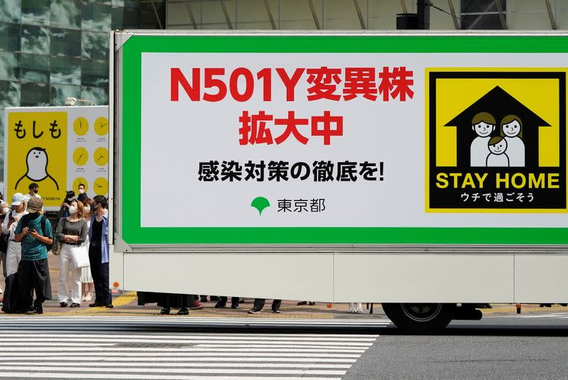 An advertisement truck, operated by Tokyo Metropolitan Government office, displaying messages that warns against the spread of the N501Y mutant COVID-19 strain, drives on the street in Tokyo