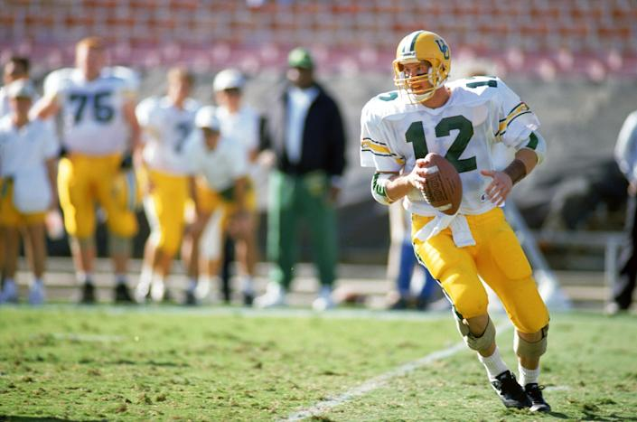 "<h1 class=""title"">Oregon Ducks v UCLA Bruins</h1> <div class=""caption""> PASADENA, CA - NOVEMBER 16: Quarterback Brett Salisbury #12 of the Oregon Ducks drops back to pass during the game against the UCLA Bruins at the Rose Bowl on November 16, 1991 in Pasadena, California. The Bruins defeated the Ducks 16-7. (Photo by Bernstein Associates/Getty Images) </div> <cite class=""credit"">Bernstein Associates</cite>"