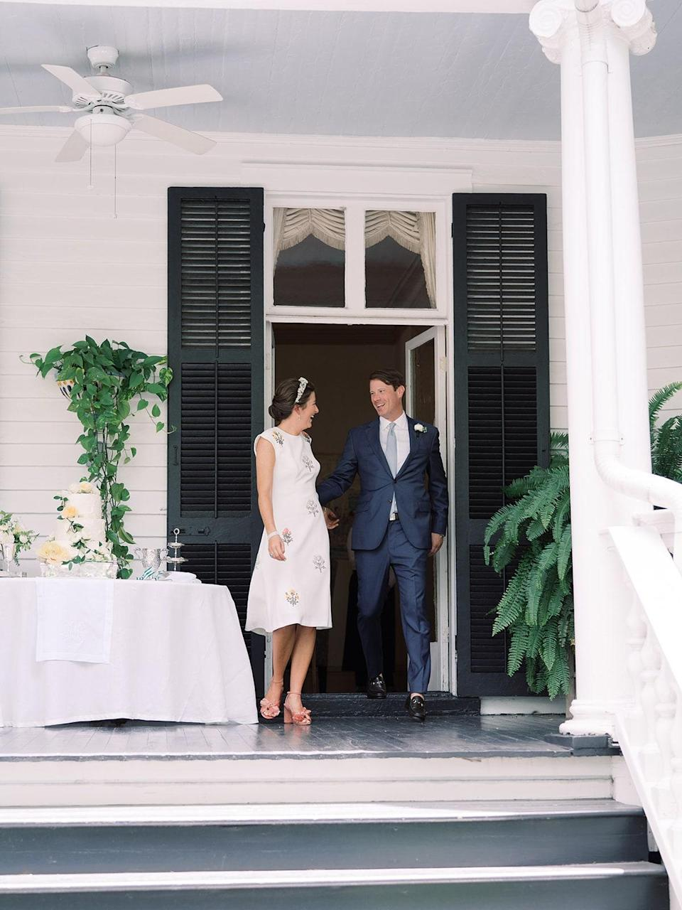 Walking out as Mr. and Mrs! We missed the first announcement because Walker was taking off his socks. I also changed my dress for the reception. This is also the porch where we met and got engaged.