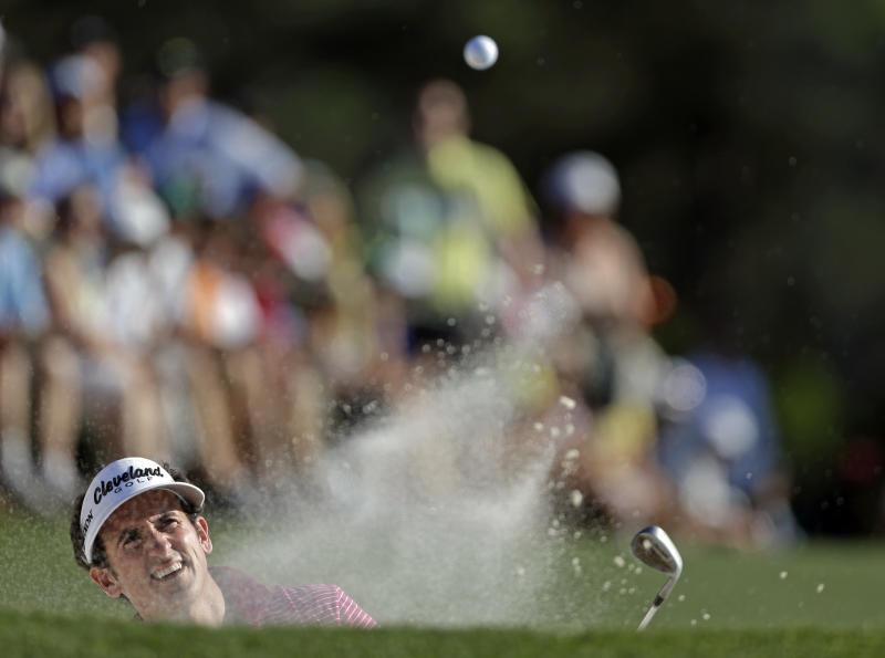 Gonzalo Fernandez-Castano, of Spain, hits out of a bunker on the 18th hole during the third round of the Masters golf tournament Saturday, April 13, 2013, in Augusta, Ga. (AP Photo/David Goldman)