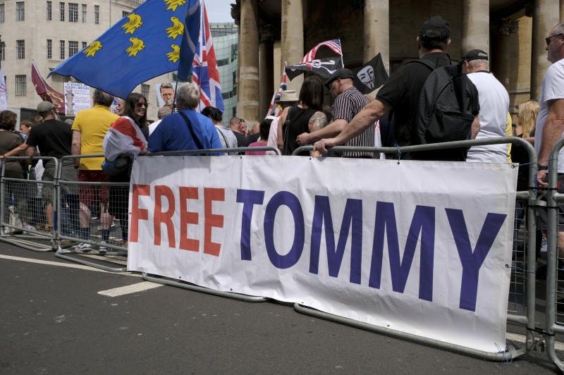 A banner saying, Free Tommy, during the rally in London. Supporters gathered outside BBC to demand the freedom of their jailed right-wing leader Stephen Yaxley-Lennon aka Tommy Robinson. During the rally, police had to intervene and raise their batons when a Police van was attacked by the Tommy Robinson supporters. A person was arrested after the confrontation. (Photo by Andres Pantoja / SOPA Images/Sipa USA)