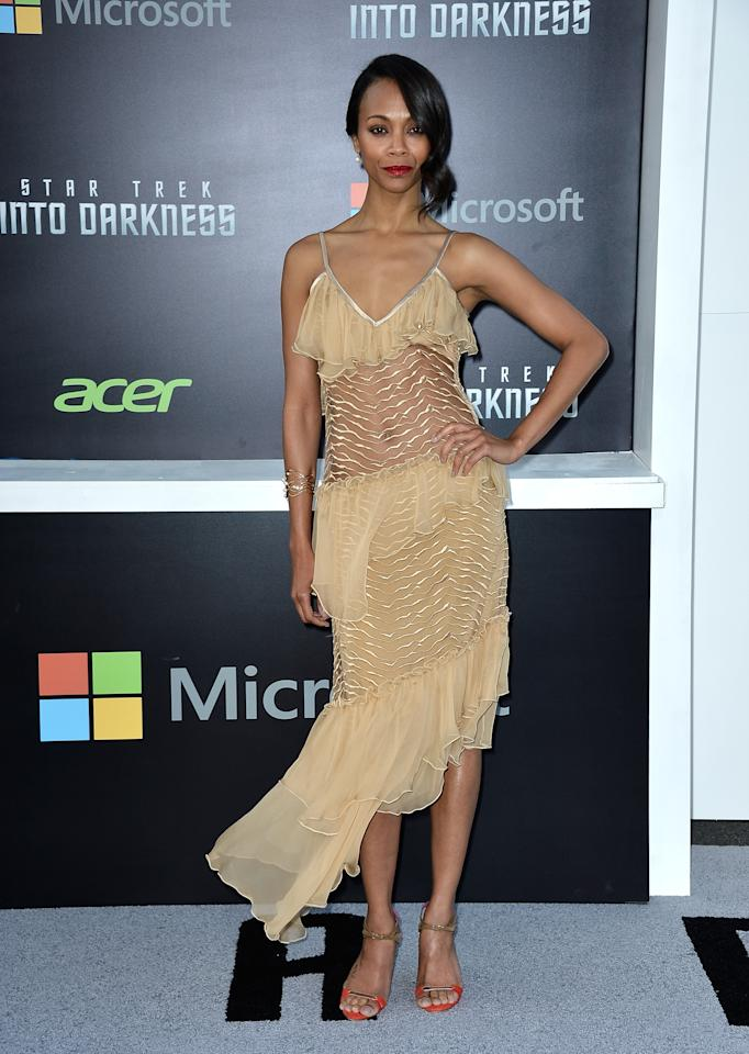 """HOLLYWOOD, CA - MAY 14:  Actress Zoe Saldana arrives at the premiere of Paramount Pictures' """"Star Trek Into Darkness"""" at Dolby Theatre on May 14, 2013 in Hollywood, California.  (Photo by Frazer Harrison/Getty Images)"""