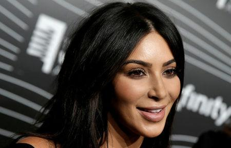 Kim Kardashian West participates in a television interview as she arrives for the 20th Annual Webby Awards in Manhattan