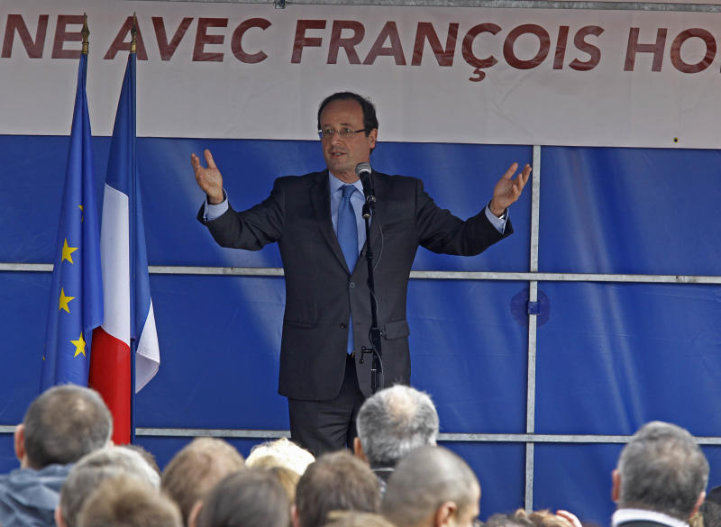 Socialist presidential candidate Francois Hollande  waves to supporters after delivering his speech outside a factory he visited in Hirson, eastern France, as part of the campaign for the second round of the French presidential elections, Tuesday April 24, 2012.(AP Photo/Remy de la Mauviniere)