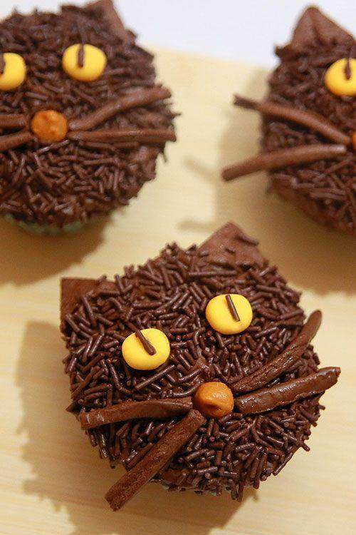 "<p>They're as fun to decorate as they are to eat.</p><p>Get the recipe from <a href=""http://onelittleproject.com/black-cat-cupcakes/"" rel=""nofollow noopener"" target=""_blank"" data-ylk=""slk:One Little Project"" class=""link rapid-noclick-resp"">One Little Project</a>.</p>"