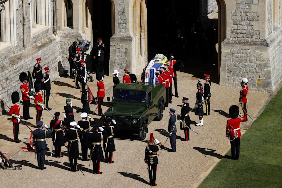 The Duke of Edinburgh's casket, covered with his personal standard, is carried to a custom Land Rover hearse for his funeral at Windsor Castle on April 17, 2021.