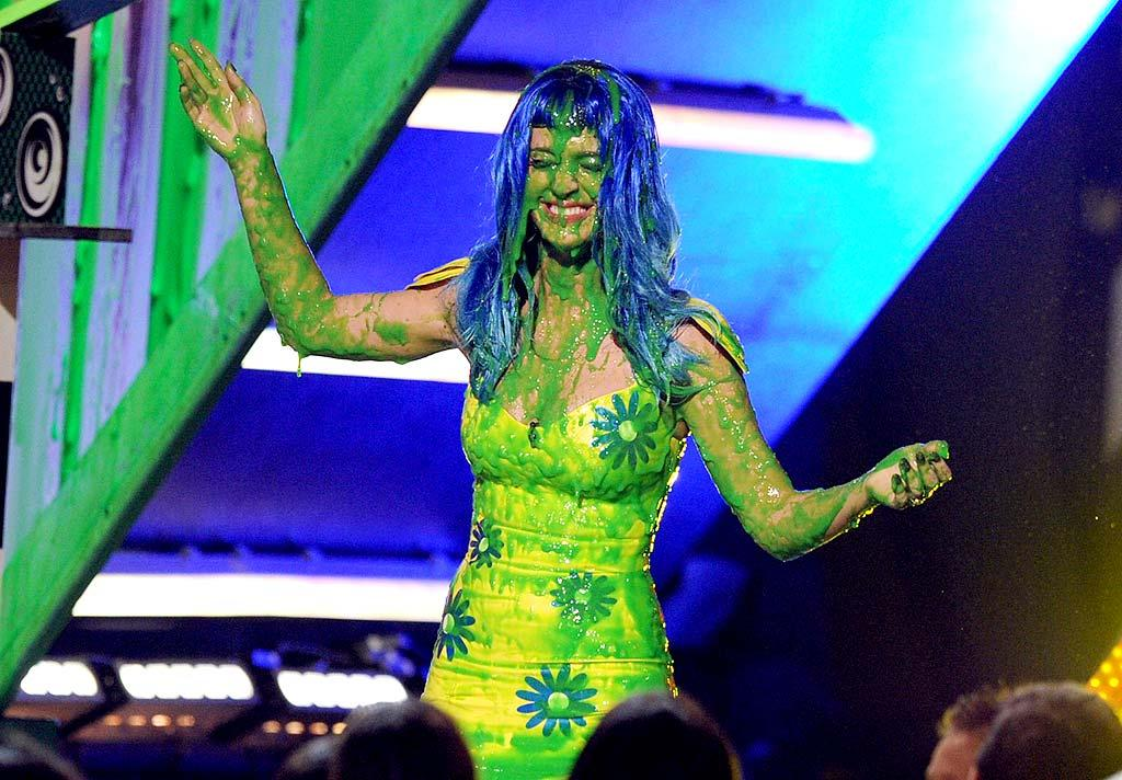 "Singer Katy Perry got her own ""award"" onstage at Nickelodeon's 23rd Annual Kids' Choice Awards Saturday. When presenting, the ""I Kissed A Girl"" singer tripped a box that was supposed to contain the winner's identity and got smacked with a load of green slime, much to the audience's delight. Kevin Winter/<a href=""http://www.gettyimages.com/"" target=""new"">GettyImages.com</a> - March 27, 2010"