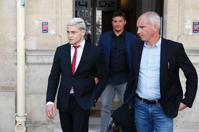 Australian international James O'Connor (L) leaves after appearing before the French National Rugby League (Ligue Nationale de Rugby, LNR) disciplinary commission in Paris on April 12, 2017, after being arrested for cocaine possession (AFP Photo/GEOFFROY VAN DER HASSELT)