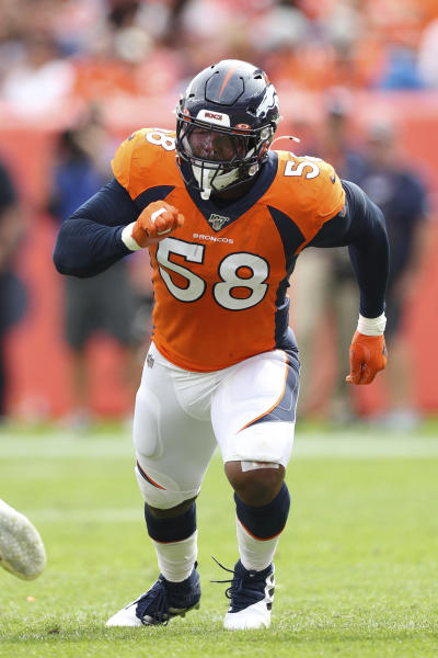 Denver Broncos outside linebacker Von Miller (58) takes a defensive position during an NFL game against the Chicago Bears, Sunday Sept. 15, 2019, in Denver. The Bears defeated the Broncos 16-14. (Margaret Bowles via AP)