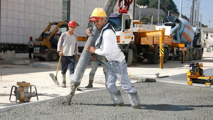 Concrete being poured by a builder
